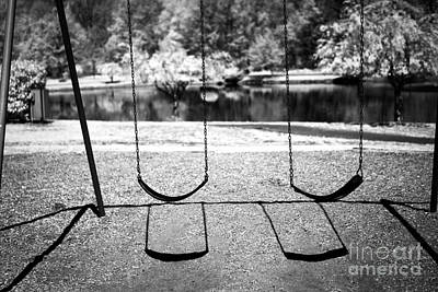 Photograph - Two Swings by John Rizzuto
