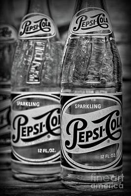 Photograph - Two Vintage Pepsi Bottles In Black And White by Paul Ward