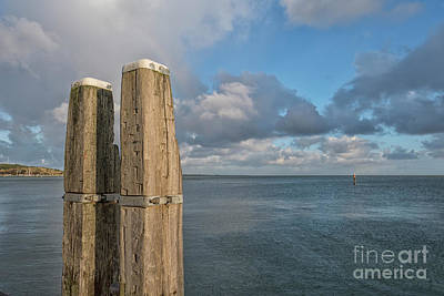 Photograph - Two Wooden Bollards by Patricia Hofmeester