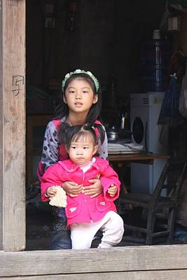 Two Young Chinese Girls In Door Of Hutong House Art Print by Thomas Marchessault