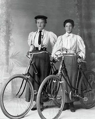 Photograph - Two Young Ladies With Their Bicycles Circa 1895 by Anthony Murphy
