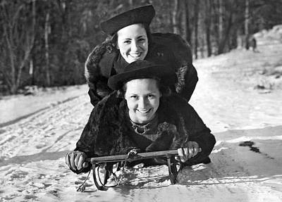 Two Young Women On A Sled Art Print by Underwood Archives