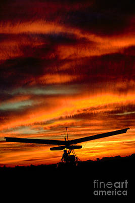 Photograph - Ultralight Into The Sunset Flying Into The Sunset Clouds by Wernher Krutein