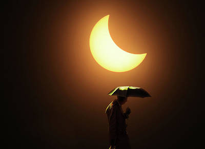 Photograph - Umbrella Man Eclipse by Christopher McKenzie