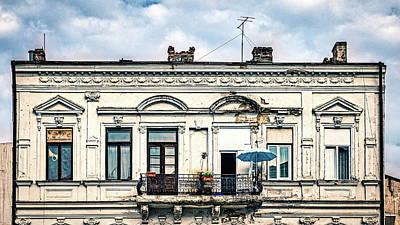 Photograph - Umbrella On The Balcony - Romania by Stuart Litoff