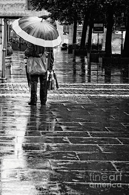 Rainy Day Photograph - Umbrella Salesman by HD Connelly