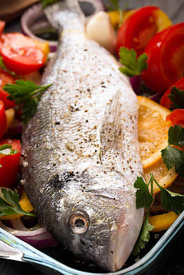 Sea Bass Photograph - Uncooked Dorado Or Sea Bass On The Fresh Vegetables by Vadim Goodwill