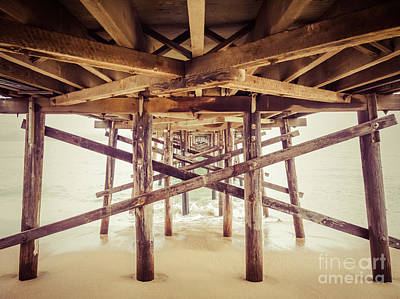 Under A Southern California Pier Art Print by Paul Velgos