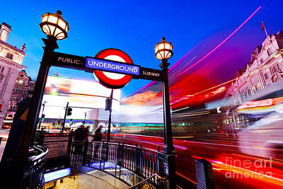 Neon Photograph - Underground Sign, Red Bus In Motion On Piccadilly Circus. London, Uk At Night by Michal Bednarek