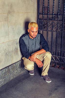Photograph - Unhappy Young Hispanic American Man Squatting At Corner, Thinkin by Alexander Image