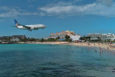 Photograph - United Airlines Landing At St. Maarten Airport by David Gleeson
