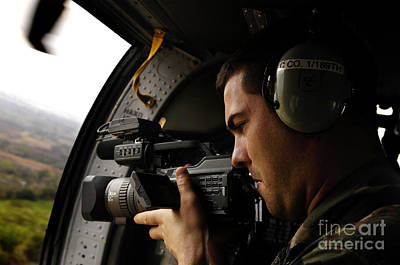 Videographer Photograph - U.s. Air Force Airman Takes Video by Stocktrek Images