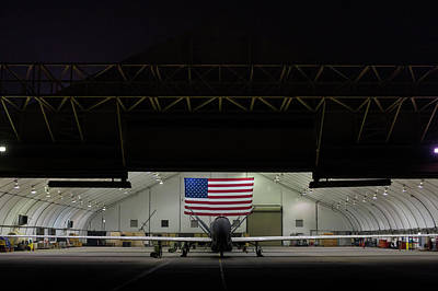 Photograph - Us Air Force Eq 4 Global Hawk Assigned To The 380th Air Expeditionary Wing Await Routine Maintenance by Paul Fearn