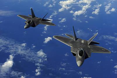 F-22 Photograph - U.s. Air Force F-22 Raptors In Flight by Stocktrek Images