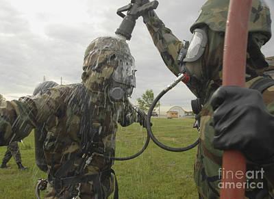 U.s. Air Force Soldier Decontaminates Art Print by Stocktrek Images