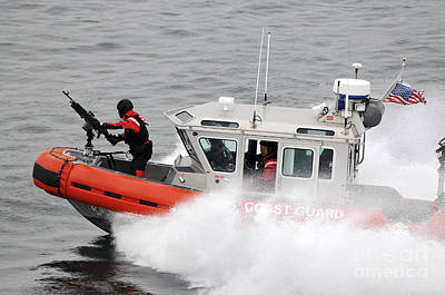 High Speed Photograph - U.s. Coast Guardsmen Aboard A Security by Stocktrek Images