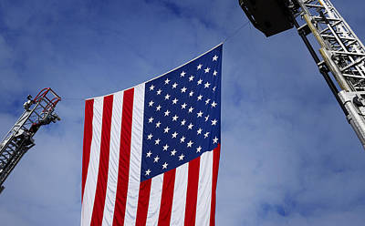Photograph - United States Flag Between Fire Ladders by Phil Cardamone