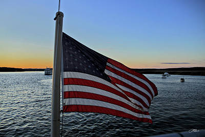 Photograph - Us Flag Flies In Front Of River At Twilight by Mike M Burke
