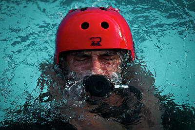 Photograph - Us Marine Corps Platoon Commander Practises Using An Emergency Breathing System At Base Pool Hawaii by Paul Fearn