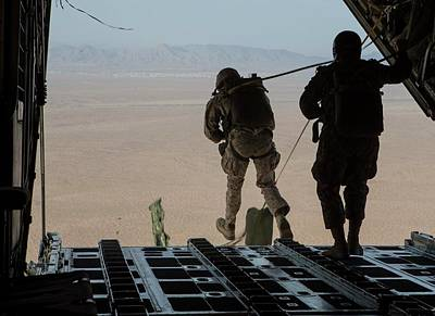 Photograph - Us Marines Conduct A Static Jump Out A Kc 130j Super Hercules Aircraft Near Yuma by Paul Fearn