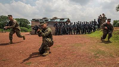 Photograph - Us Marines Demonstrate Bounding Toward An Objective As A Squad Sri Lanka  by Paul Fearn