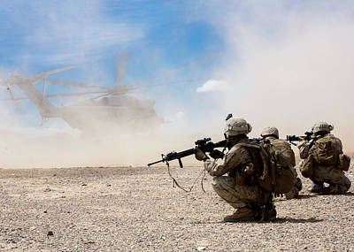 Photograph - Us Marines Provide Security During A Ch53 Day Battle Drill by Paul Fearn