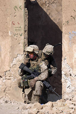 Abandoned Houses Photograph - U.s. Marines Taking Cover In An by Stocktrek Images