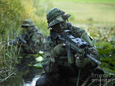 U.s. Navy Seals Cross Through A Stream Art Print