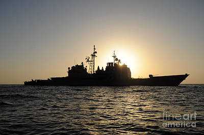 Piracy Painting - Uss Anzio With Setting Sun by Celestial Images