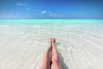 Photograph - Vacation On Tropical Beach In Maldives. Woman's Legs In The Clear Ocean by Michal Bednarek