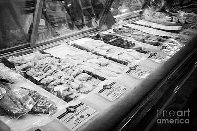 Fish Fillet Photograph - various fish fillets for sale at reading terminal market food court Philadelphia USA by Joe Fox