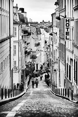 Vers Le Haut De La Rue Art Print by John Rizzuto