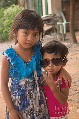Photograph - Vertical Mcu Of Two Girls In Rural Asia, One With Dark Sunglasses by Jason Rosette