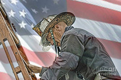 Photograph - Veteran Fire Fighter Climbing Down From The Roof II by Jim Fitzpatrick
