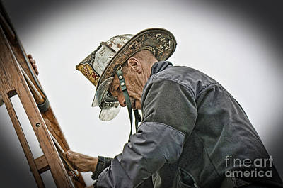 Photograph - Veteran Fire Fighter Climbing Down From The Roof by Jim Fitzpatrick