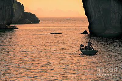 Photograph - Vietnamese Fishermen Voyage Home Ha Long Bay  by Chuck Kuhn