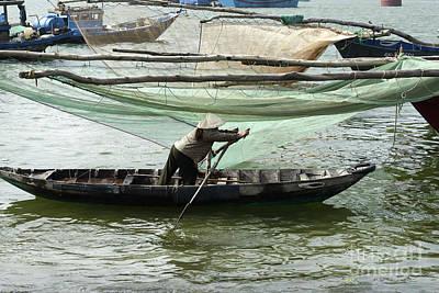 Travel Photograph - Vietnamese Woman Paddling Alongside Large Fishing Nets  by Dani Prints and Images