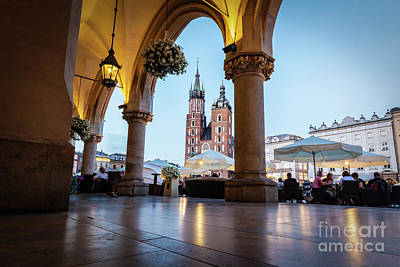 Photograph - View From The Cloth Hall To The Cracow Main Market Square And St. Mary's Basilica by Michal Bednarek