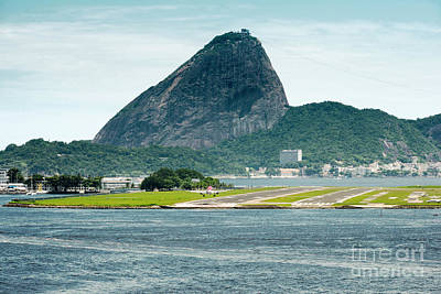 Cities Photograph - View Of A Passenger Airplane Landing At The Rio De Janeiro Airport With The City At The Background by Dani Prints and Images
