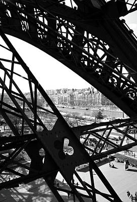 Photograph - View Of River Seine Through The Iron Struts Of The Eiffel Tower Paris France Black And White by Shawn O'Brien