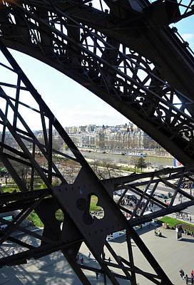 Photograph - View Of River Seine Through The Iron Struts Of The Eiffel Tower Paris France by Shawn O'Brien