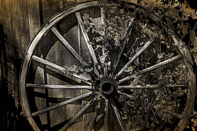 Photograph - Vine Overgrown Wagon Wheel by Randall Nyhof