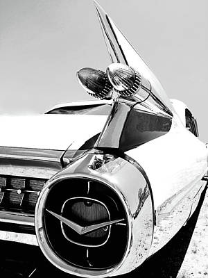 Photograph - Vintage Cadillac Tail Lights And Fin In Black And White by Kelly Hazel