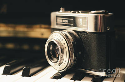 Photograph - Vintage Camera On Piano by Edward Fielding