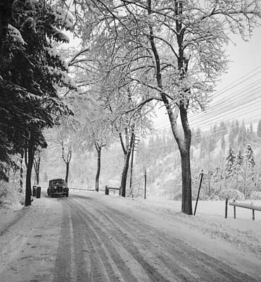 Photograph - Vintage Car On A Winter Road by German School