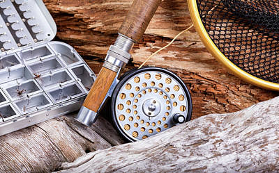 The Playroom - Vintage fly fishing outfit and gear on rocks and wood background by Thomas Baker