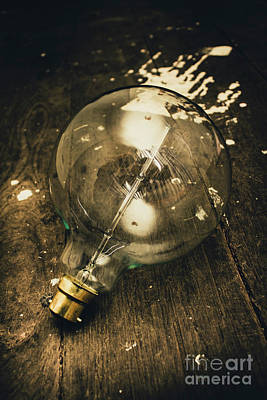 Vintage Light Bulb On Wooden Table Art Print