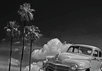 Photograph - Vintage Plymouth Automobile In Black And White Against Palm Trees by Randall Nyhof