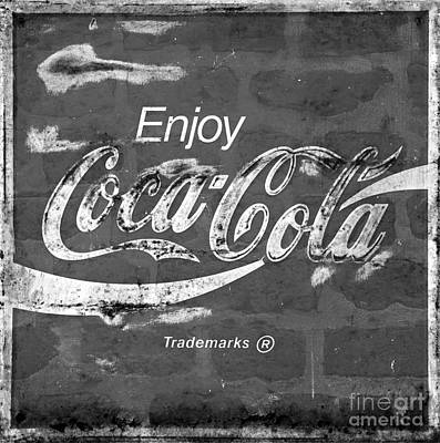 Photograph - Vintage Weathered Coca Cola Sign Brick Wall Black And White by John Stephens