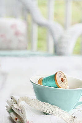 Photograph - Vintage Wooden Spools Of Thread In Vintage Tea Cup by Stephanie Frey